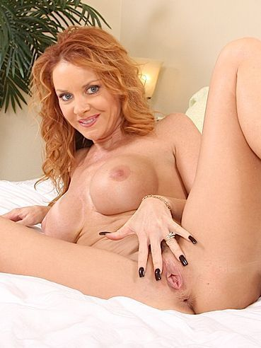 Gorgeous long haired redhead mom Janet Mason in high heels enjoys metal dildo in her pussy