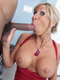 Big boobed blonde mommy Morgan Ray takes a shocking cock in her mouth and cunt