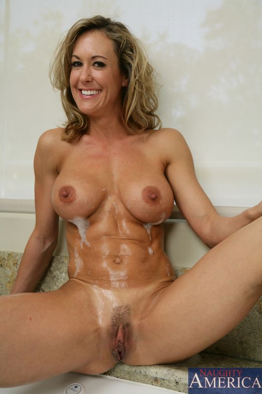 Slender busty milf Brandi Love shows her muscled slim belly and gets ...